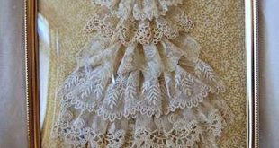 Christmas tree made of vintage lace and vintage jewelry in an ornate frame by ca...