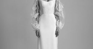 'RITA' WEDDING GOWN A fitted corset wedding dress with a twist, featurni...