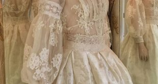 Edwardian lace wedding dress with a high neck blouse and silk skirt